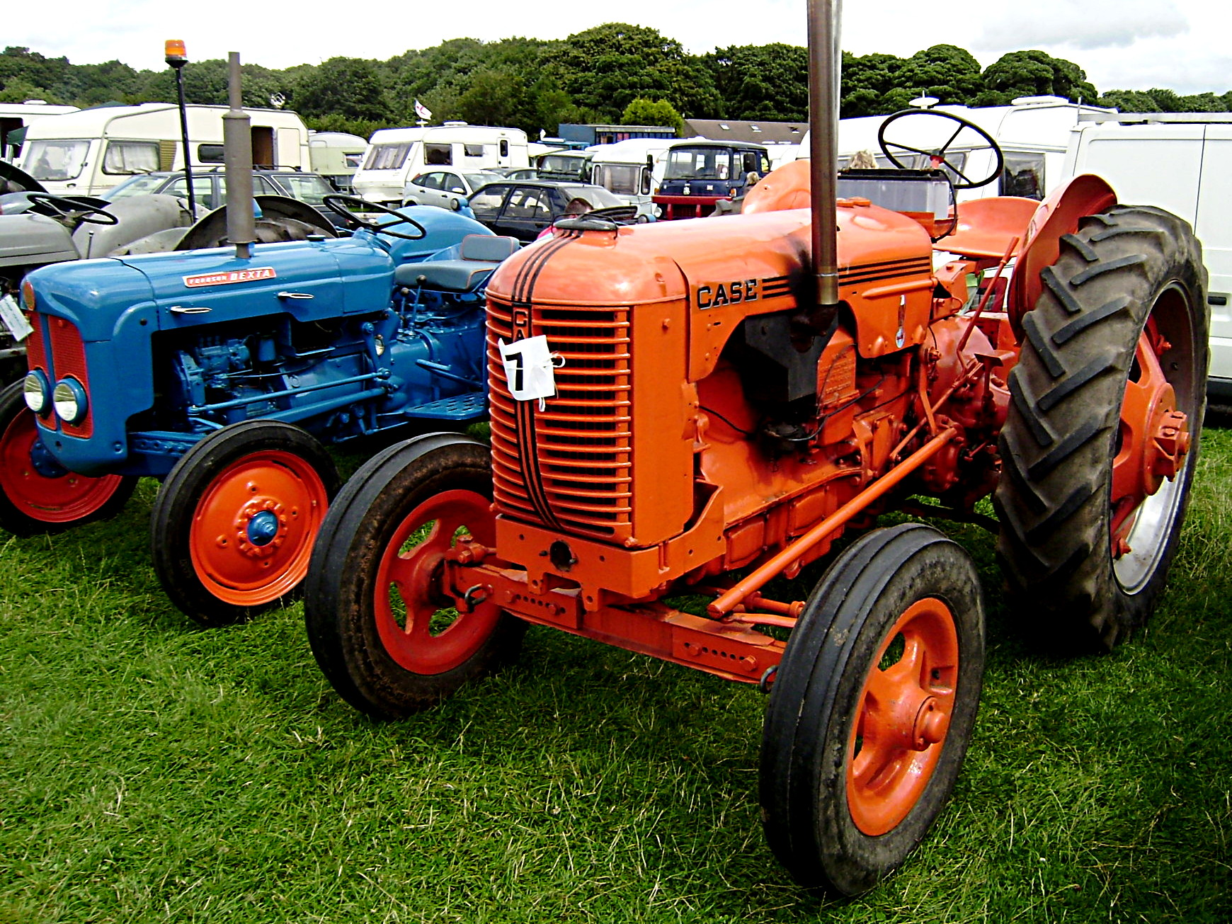 A Case tractor (right) and a Fordson Dexta tractor (left) at Cromford Steam Rally 2008, Derbyshire, England. Via Wikipedia.