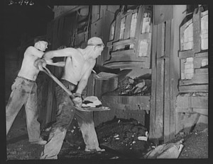 Workers charging the Open Hearth Furnace. This older technology required many skilled workers. Library of Congress  LC-USE6- D-000996